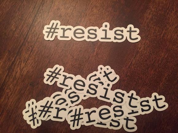 Pile of #resist stickers die-cut