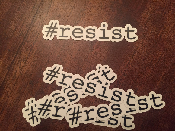 Pile of #resist stickers die-cut